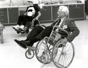 "Dr. Johnson demonstrating a ""wheelie"", 1990"