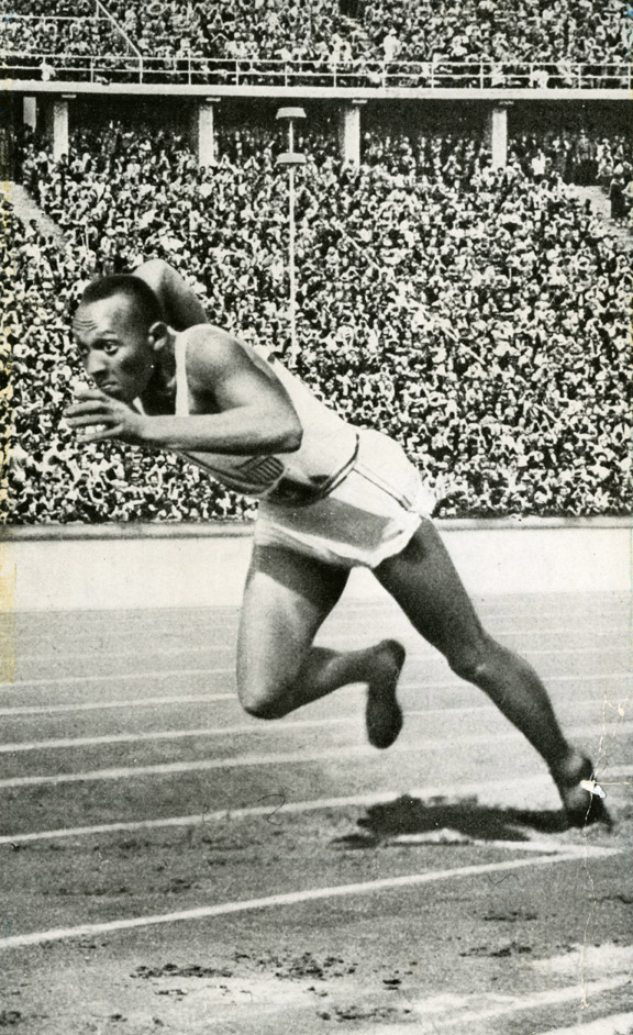 Owens competing in the 200 meter dash at the Berlin Olympics, 1936