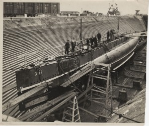 The Nautilus being outfitted in a dry dock.
