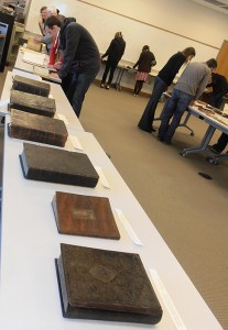 Photo of old printed books lined up on a table