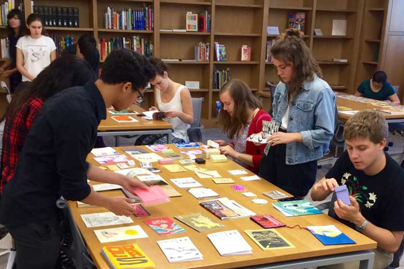 Students using resources in the Billy Ireland Cartoon Library & Museum reading room.
