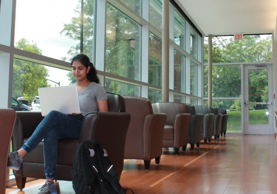 Studying in comfy chairs by the windows in the FAES Library & Student Success Center