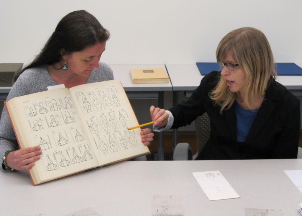 women discussing a watermark