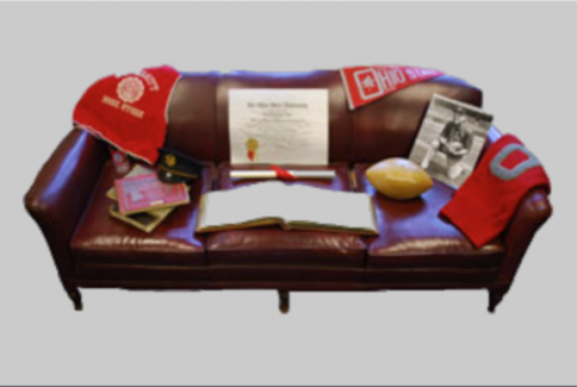 Woody Haye's couch covered with Ohio State memorabilia at University Archives
