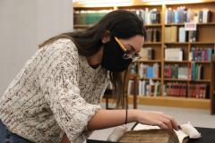 Graduate student Tamara Mahadin examines one of the manuscripts she and her fellow students selected for purchase, a mid-15th century copy of Bernard de Parentis' commentary on the Mass.