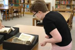 Maggie Wilson, PhD candidate and MedRen 5610 class member, pages through a rare collection of sermons by the 15th-century Italian preacher, Cherubino da Spoleto.